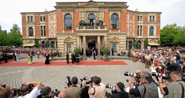 "Guests arrive at the ""Festspielhaus"" for Bayreuth Wagner music festival in 2008:  this year's festival has been plagued with drama, from conductors walking out to organisers rescinding its invitation to German performance artist Jonathan Meese in horror at the running costs for his proposed staging. Photograph: Joerg Koch/AFP/Getty"